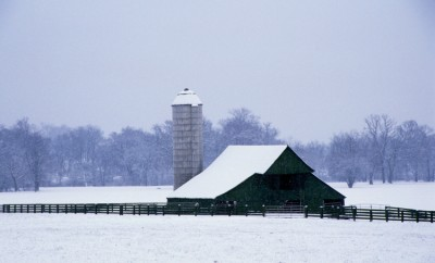 Snow-covered barn and silo